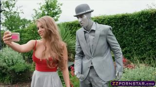 Busty chick fucks a living statue performer outdoors